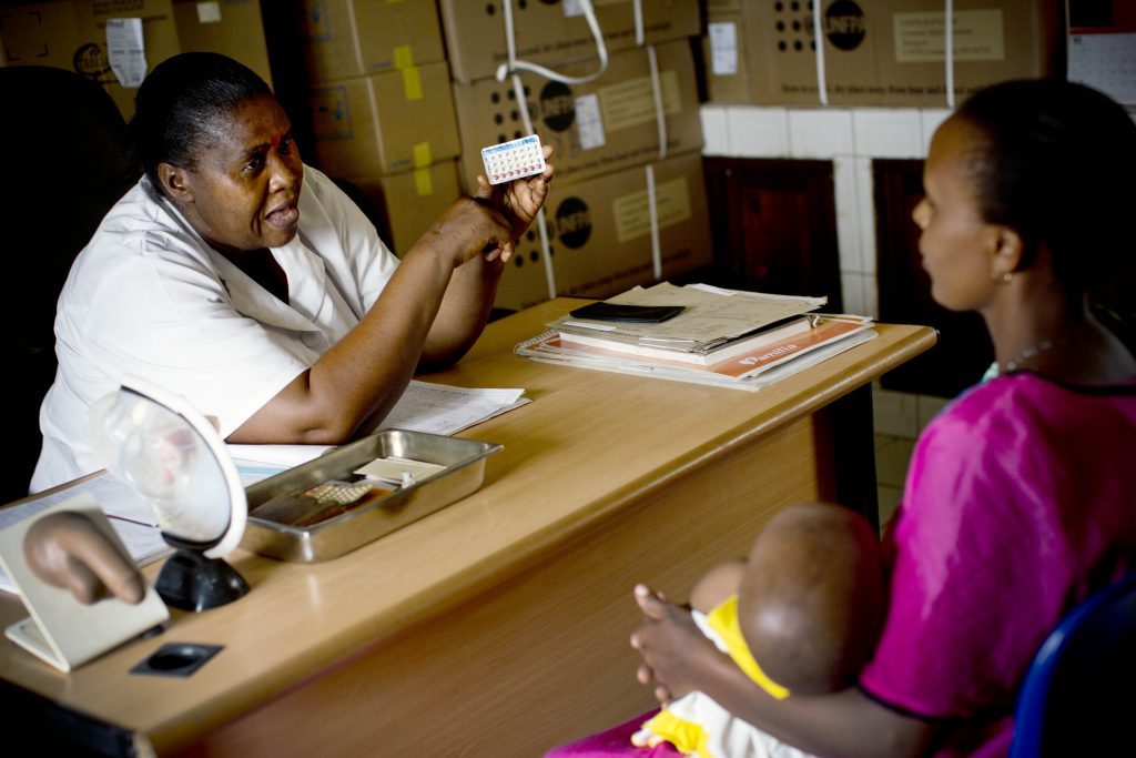 Health worker discusses family planning with a Tanzanian mother.