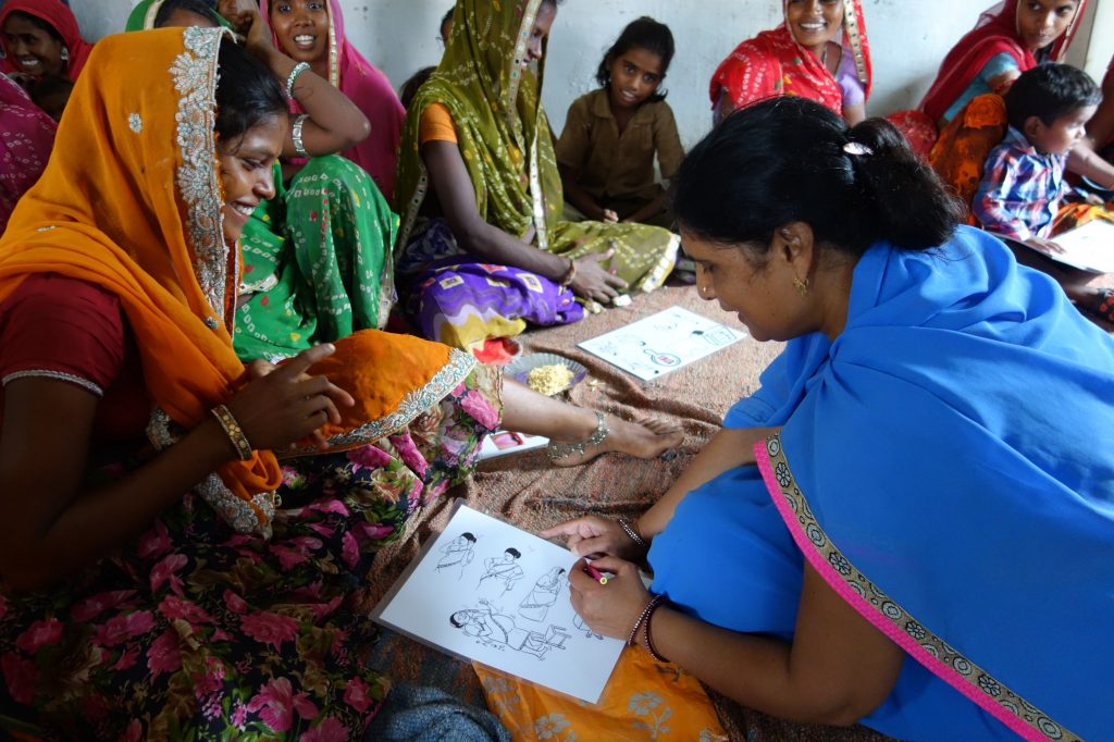 Woman in India receiving prenatal instructions.
